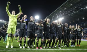 Chelsea celebrate after winning the title with a victory at West Brom.