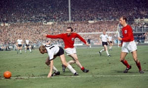 Siegfried Held of West Germany evades England's Nobby Stiles and Jack Charlton (right) during the 1966 World Cup final.