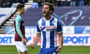 Will Grigg celebrates scoring Wigan's second goal in the FA Cup fourth round victory over West Ham.