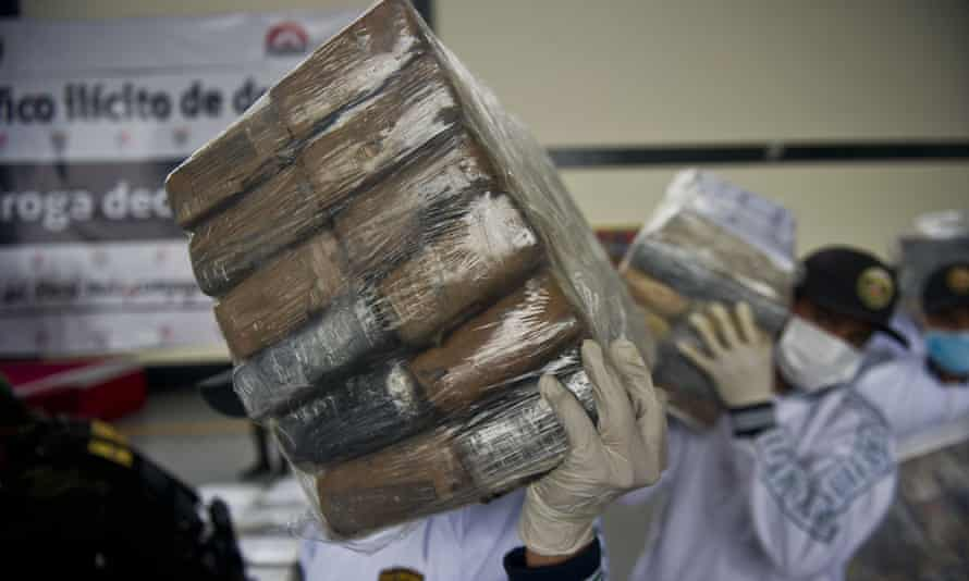 Police officers seize packages of cocaine at the airport in Lima in 2014.