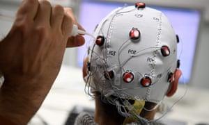 A researcher uses a brain-computer interface helmet at the Centre National de la Recherche Scientifique, Grenoble.