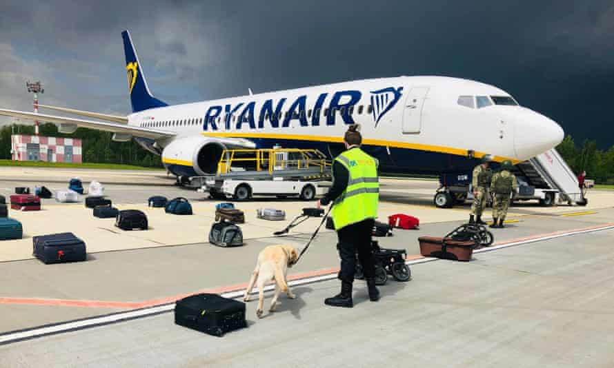 Security with a sniffer dog in Vilnius checking luggage in front of Ryanair flight FR4978, which carried opposition journalist Roman Pratasevich