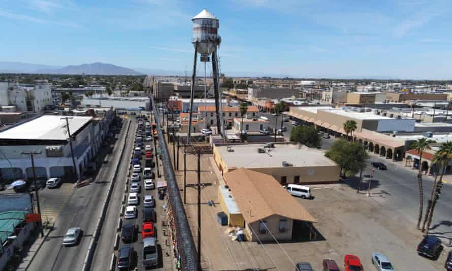 Motorists wait in line to cross the border into Calexico, California, from Mexicali, Mexico