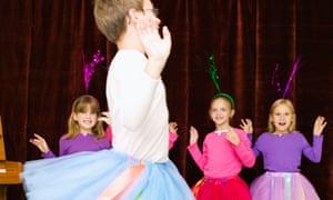 Ballerinas Dancing in School Pageant