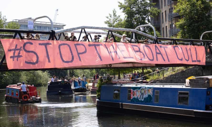 Boat passing under banner