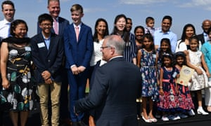 Scott Morrison speaks with newly sworn citizens during Australia Day citizenship ceremony in Canberra.