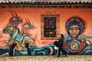 Cultural echoes. Colombian street artist Guache is known for combining ancestral imagery with geometric patterns and shapes. His vibrant work can be found throughout Bogotá.