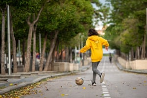A girl plays with a ball in Madrid