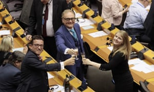 John Longworth, centre, who was elected as a Brexit party MEP but who now backs the Conservatives, celebrating with colleagues after the vote in favour of the withdrawal agreement.