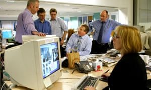Editor Simon Kelner (seated centre) pioneered the idea of the 'viewspaper' and the transition to a tabloid format.