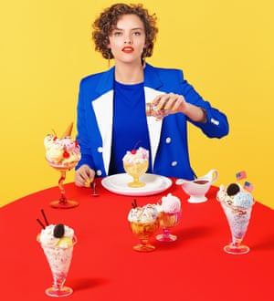 Cook and food writer Ruby Tandoh surrounded by puddings
