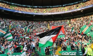 Celtic fans fly Palestine flags during their Champions League play-off against Hapoel Be'er Sheva.