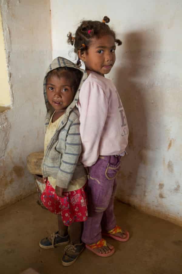 Rova, a chronically malnourished five-year-old girl, stands next to her friend Jiana Rakuturammambason
