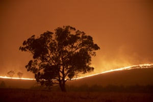 Canberra, Australia: the Clear Range fire burns near Bredbo North shortly before reaching the Cowie family's property. The couple stayed to defend their home
