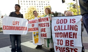 Demonstrators calling for the Catholic church to include female priests gather prior to the arrival of Pope Francis at the Cathedral of St Matthew the Apostle.