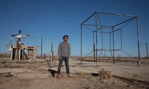 Tao Ruspoli, a film-maker, poses with art from the Bombay Beach Biennale.