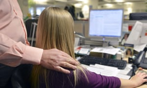 Female office worker receiving unwanted physical advances from a male co-worker