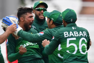 Amir celebrates with teammates after taking Amla LBW for two.