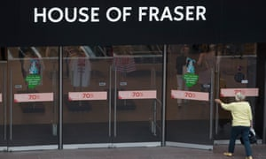 Woman entering House of Fraser store in Bristol