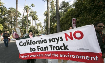 Los Angeles residents take to the streets on 7 May to demand that Hillary Clinton oppose the Trans-Pacific Partnership and Trade Promotion Authority.