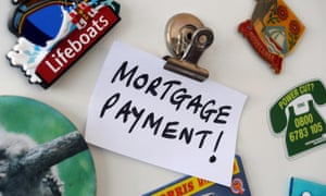 A mortgage payment alert note on a fridge.