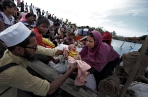 Cox's Bazar, Bangladesh. Newly arrived Rohingya refugees board a boat as they are transferred to a camp