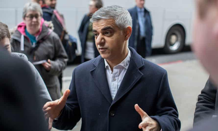 Sadiq Khan talking to commuters at London Bridge station