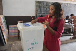Abidjan, Ivory CoastA woman casts her ballot at a polling station in Port-Bouët during local elections