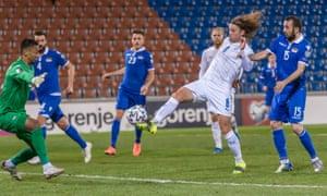 Birkir Bjarnason sticks the ball past Liechtenstein's keeper Justin Ospelt for Iceland's second goal.