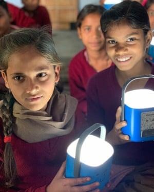Children with Philips LifeLight solar lanterns