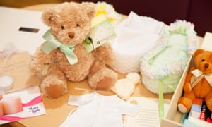 A teddy bear and small knitted cribs are among the gifts given to bereaved families.