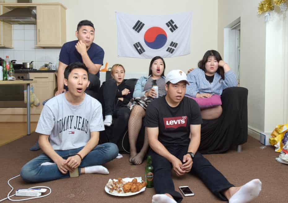 South Korea football fan Lee Jaeyoung (back left) with friends in Bradford, 23 June 2018