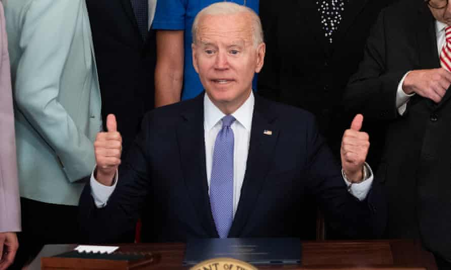 TOPSHOT-US-POLITICS-BIDEN-CRIMES-ACT<br>TOPSHOT - US President Joe Biden gives thumbs-up after signing H.R. 1652, the VOCA Fix to Sustain the Crime Victims Fund Act of 2021, which redirects monetary penalties to increase funding for victim compensation funds, during a ceremony in the East Room of the White House in Washington, DC, July 22, 2021. (Photo by SAUL LOEB / AFP) (Photo by SAUL LOEB/AFP via Getty Images)