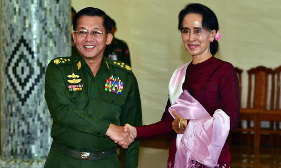 Min Aung Hlaing shakes hands with Aung San Suu Kyi