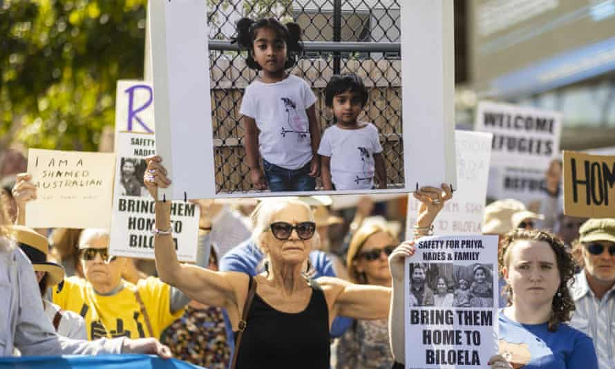 Supporters of Tamil asylum seekers Nadesalingam and Priya and their Australian-born children Kopika and Tharunicaa are seen at a rally outside Brisbane City Hall on Sunday.