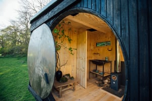 A padded sleeping area behind a circular doorway that rolls open is one of the attractions of woodland-inspired Animated Forest by Francis and Arnett. Rooflights allow for stargazing at night.