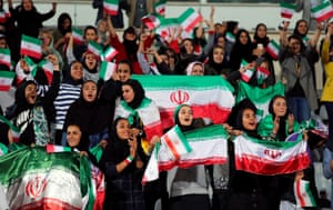 Iranian women watch the match between Iran and Bolivia in Tehran.