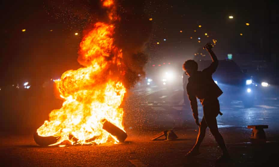 A protester burns tires and wood during a  demonstration in bangkok.