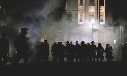 Police move into protester lines through clouds of teargas in Kenosha, Wisconsin, on 25 August 2020.