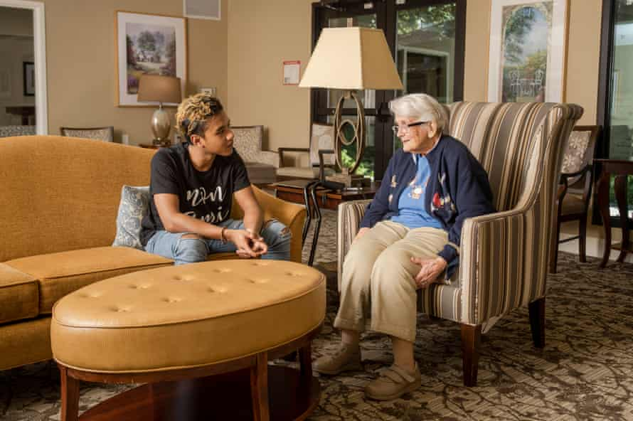 Marck Rakotoson, left, visits with Pat Hubbard at the BridgePoint senior living facility in Los Altos, California.