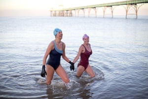 Brave members of the Yeo Valley life savers take a morning swim in Clevedon, Somerset