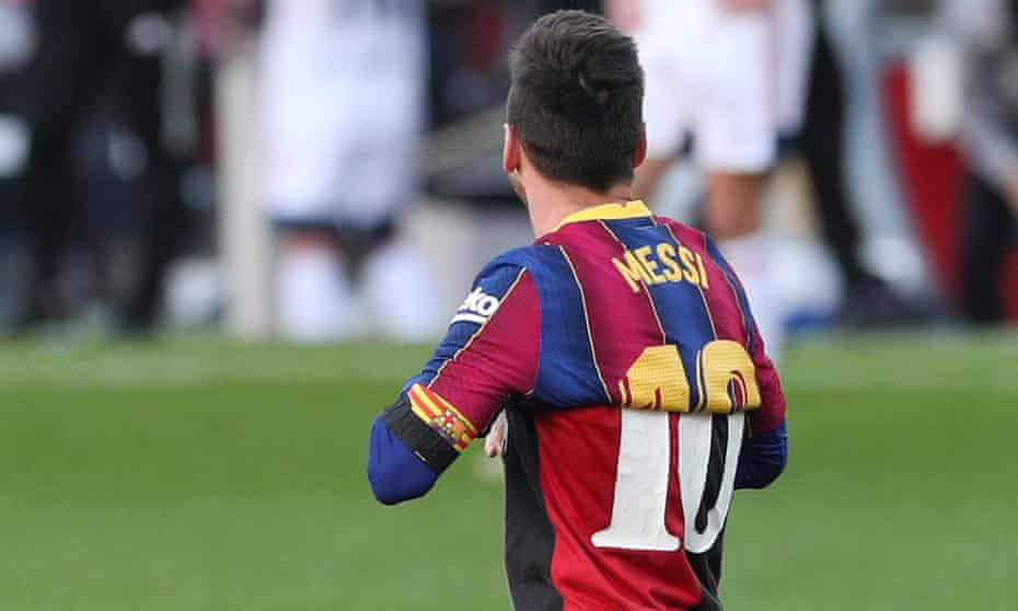 Lionel Messi wears a Newell's Old Boys shirt in memory of Diego Armando after scoring in Barcelona's thumping win against Osasuna.