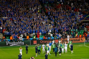 Iceland players applaud the fans.