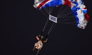 An actor dressed as the Queen parachutes during the opening ceremony of the London 2012 Olympic Games.