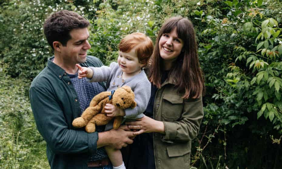 Matt and Clemmie Collins with their son in the garden at Benton End in Suffolk.