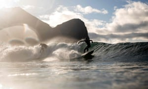 Unstad, Norway: A surfer rides a wave during the Lofoten Masters, the world's most northerly surfing contest, held within the Arctic Circle
