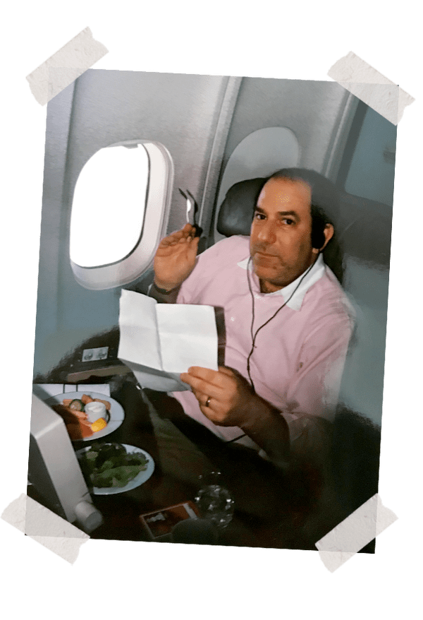 Dad eating on an international flight, circa 1996.