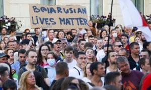 People gather at a detention centre in Minsk, Belarus