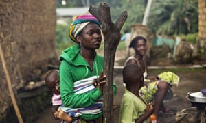 Women and children in the Guinean village of Meliandou