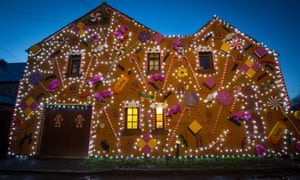 Somerset Pub Transformed Into Gingerbread Inn For ChristmasWELLS, ENGLAND - DECEMBER 13: Lights illuminate the Queen Victoria Inn in the village of Priddy that has been transformed into a giant gingerbread house in time for Christmas, near Wells on December 13, 2017 in Somerset, England. Renamed The Gingerbread Inn, which now features giant candy canes, sherbet, lollipops, liquorice allsorts, gingerbread men and also a giant Christmas tree made up of recycled bottles and has been described by its creator as the world's largest gingerbread inn. (Photo by Matt Cardy/Getty Images)